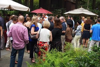 Axelia Partners' guests gathering at the garden party