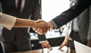 Hiring handshake following successful interview